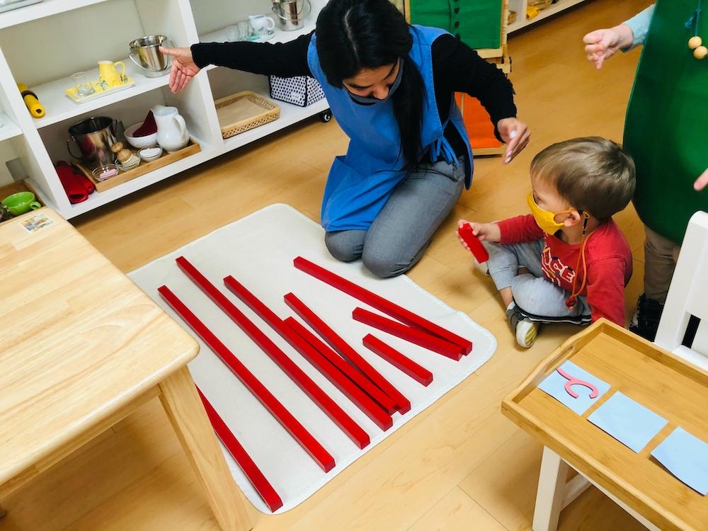 Boy learning math with Teacher guidance at La Jolla Montessori School.jpg